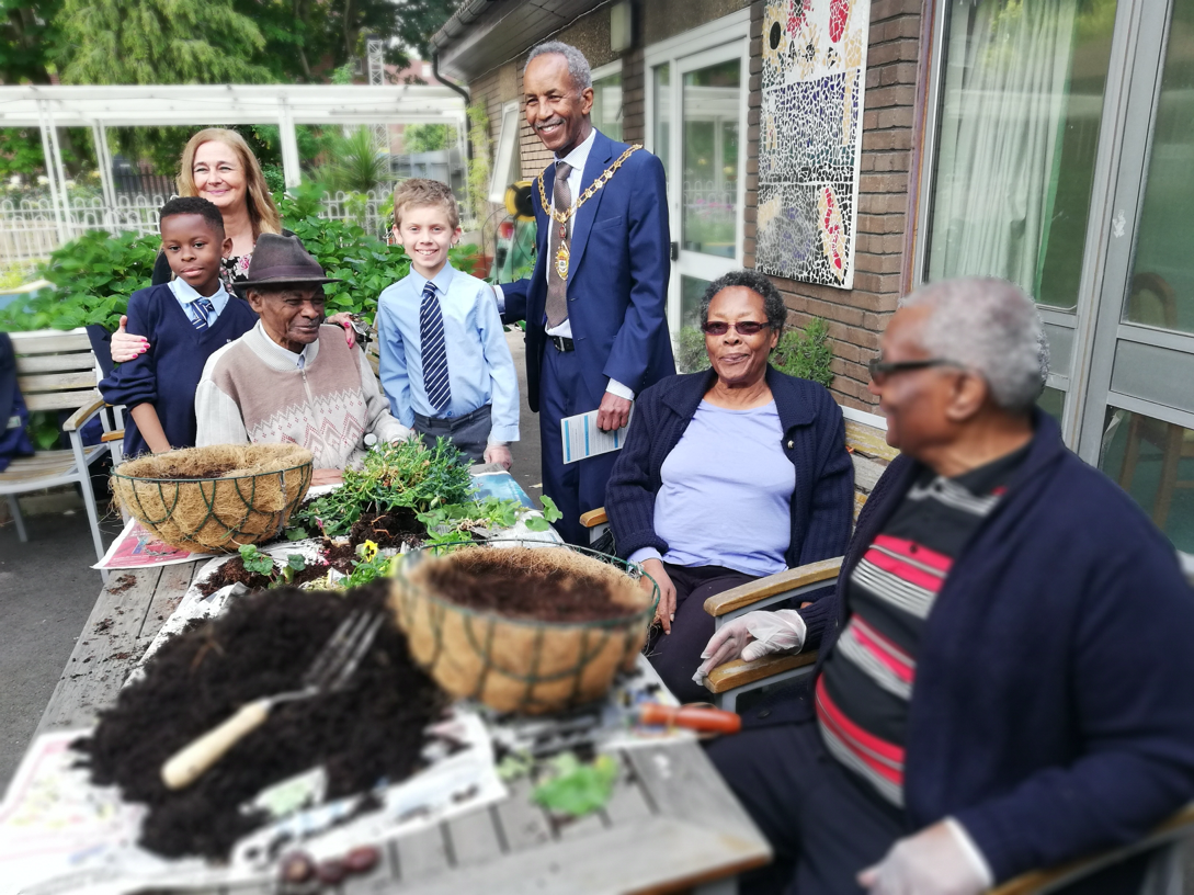 Intergenerational planting at Michael Flanders Resource Centre